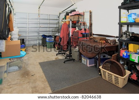 A messy and cluttered garage used as storage for junk that has been collected over the years