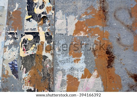 A metal billboard background with peeling posters and texture - stock photo