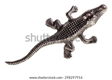 a metal crocodile figurine isolated over a white background - stock photo