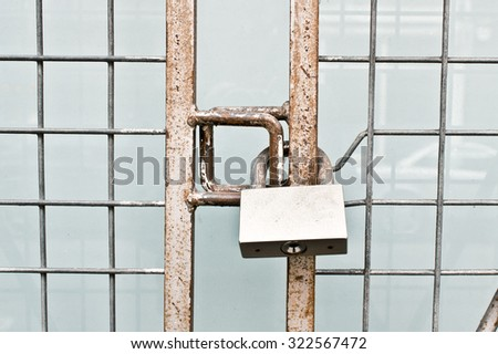 A metal gate locked - stock photo