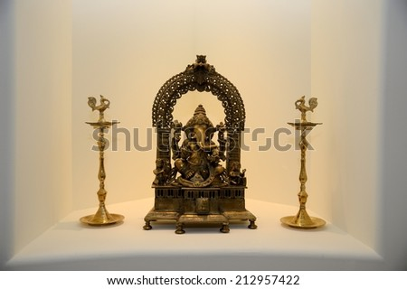 A metal statue of ganesha with musical instruments - stock photo