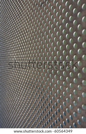A metal texture over a green background (selective focus, photographed with shallow DOF) - stock photo