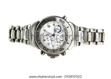 a metal wristwatch isolated over a white background - stock photo