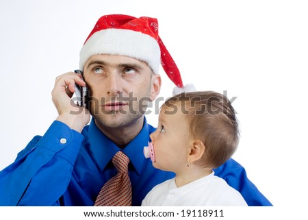 A metaphorical image of a man wearing a Christmas cap trying to juggle between fatherhood and business. - stock photo