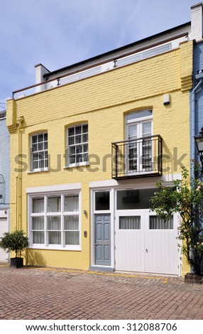 A mews house converted from an 18th century stable carriage building, in Kensington, London, UK. - stock photo