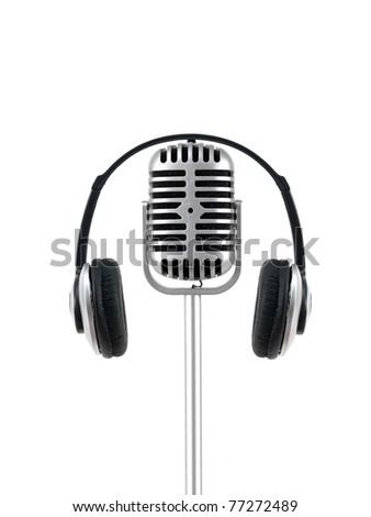A microphone and headphones isolated against a white background - stock photo