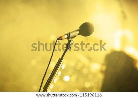 a microphone on a stage.... - stock photo