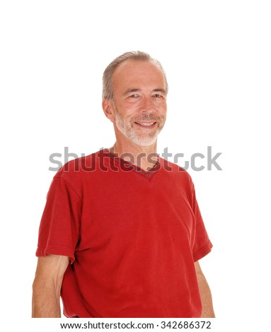 A middle age male in a red t-shirt standing isolated in a closeup image for white background and smiling. - stock photo