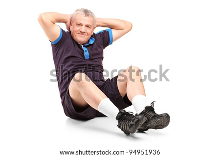 A middle age senior man exercising isolated on white background