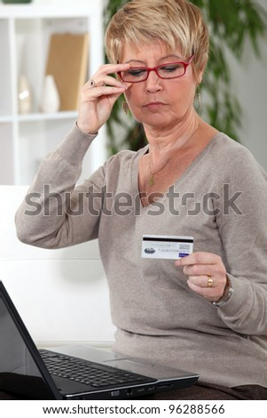 A middle age woman online shopping. - stock photo