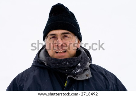 A middle-aged man is outside during a cold winter day