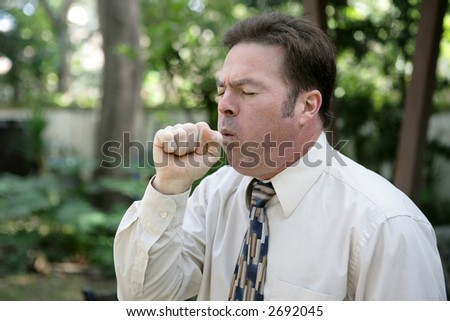 A middle aged man with a severe cough. - stock photo