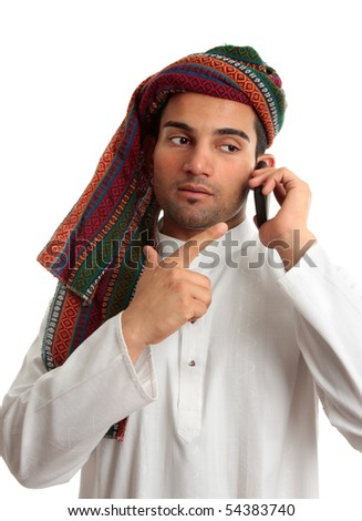 A middle eastern businessman talks on a mobile cell phone.  White Background. - stock photo
