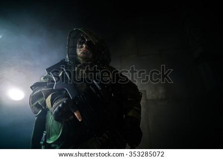 A military man with a machine gun. Fantasy. The post Apocalypse. - stock photo