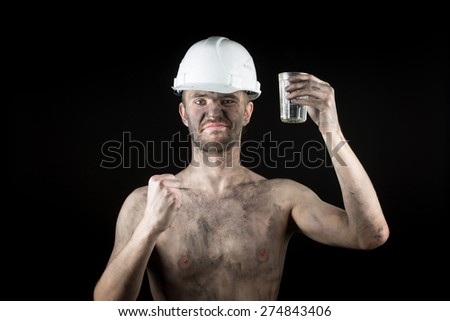a miner with a glass of vodka - stock photo
