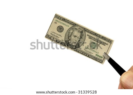 a miniature twenty dollar bill held by tweezers represents our world wide shrinking economy isolated on white - stock photo