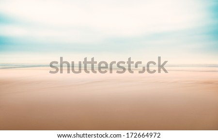 A minimalist, abstract seascape with panning motion combined with a long exposure.  Image displays a fine grain texture at 100 percent. - stock photo