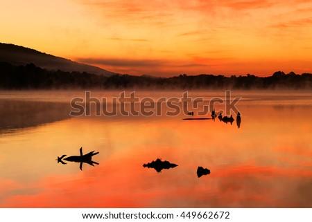 A misty sunrise at Locust Lake State Park, Schuylkill County, Pennsylvania, USA. - stock photo