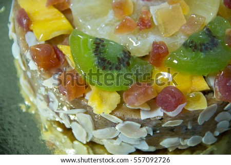 A mix fruits cake with almond nut and dried fruit.