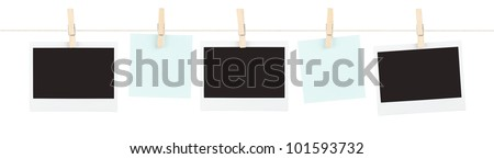 A mix of blank film and sticky notes held on a string isolated on white.