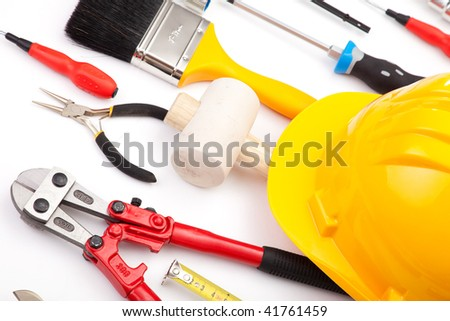 a mix of construction tools over a white background - stock photo
