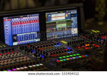 A mixing console, or audio mixer,shallow dof - stock photo