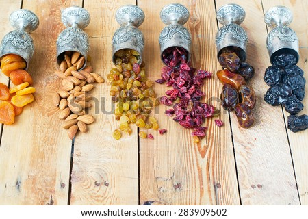 A mixture of dried fruits and nuts - stock photo
