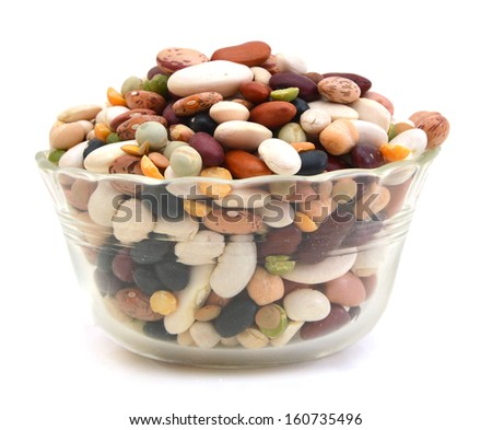 A mixture of legumes in glass bowl, white background.  - stock photo