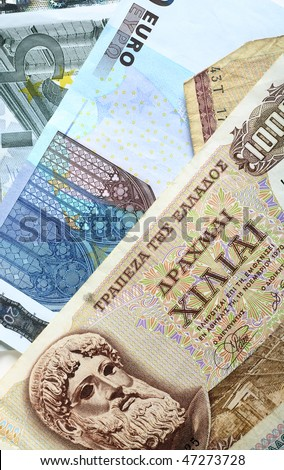 A mixture of old Greek drachma banknotes and euro notes that succeeded them. Greece's adoption of the single currency is now seen as posing undermining the euro exchange rate. - stock photo