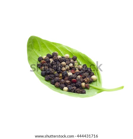 A mixture of peppers and basil leaves  - stock photo