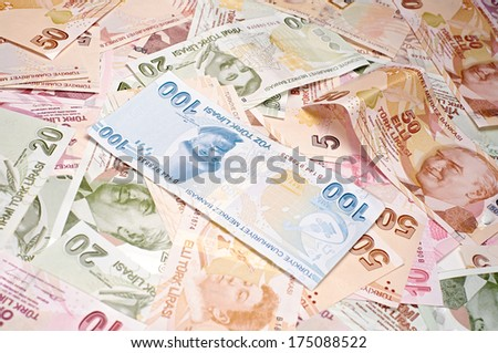 A mixture of Turkish Lira Currency, on a white background. - stock photo