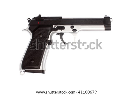A 9 mm pistol on a table.