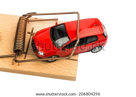 a model car in a mousetrap, symbolic photo for car expenses and debts - stock photo