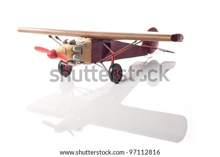 A model of an old airplane - stock photo