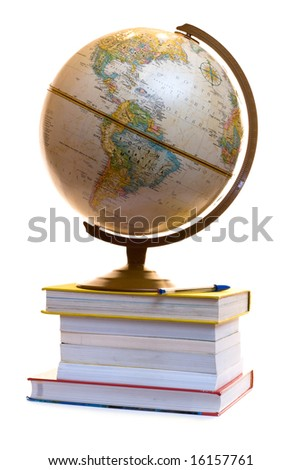 A model of the globe sitting on a pile of text books, isolated on a white background - stock photo