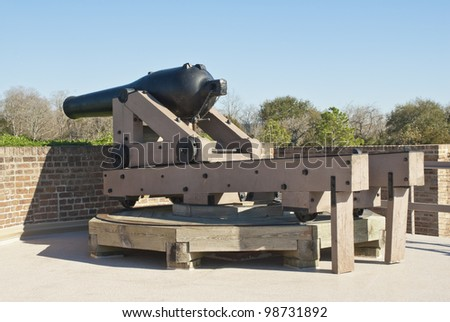 A Model 1846 32 Pound Cannon and artillery magazine on the rampart of Fort James Jackson in Savannah Georgia. - stock photo