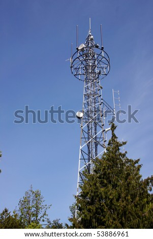 A modern antenna with blue sky background. - stock photo