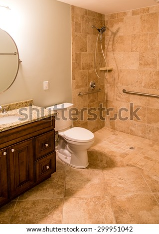 A modern bathroom with tile compliant with Americans with Disability Act - stock photo