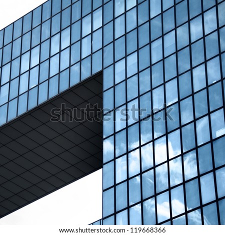 A modern building mirror facadein blue tone - stock photo