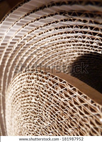 A modern corrugated cardboard lamp made out of recycled pasteboard - stock photo