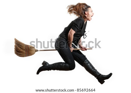 A modern day witch flying on her broomstick on white - stock photo