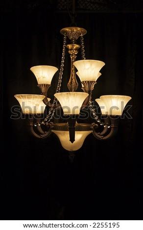 A modern design of hanging chandelier lights. - stock photo