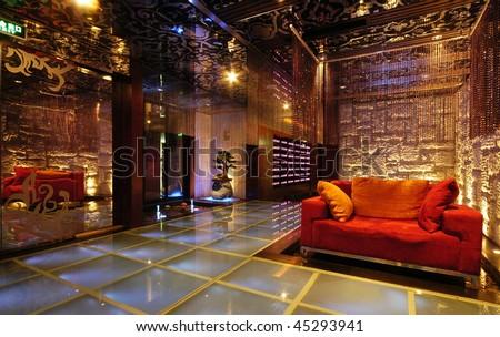 A modern fabric sofa in the night club. - stock photo