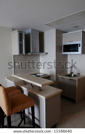 A modern family kitchen with cupboard and buffet.