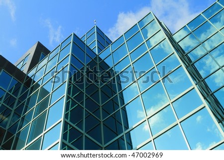 A modern glass fronted building - stock photo