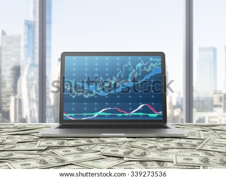 A modern laptop with forex chart on the screen. The laptop is on the table which is covered by dollar notes. New York panoramic view from the office. 3D rendering. - stock photo