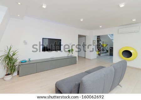 A modern living room with a table and fancy sofa  - stock photo