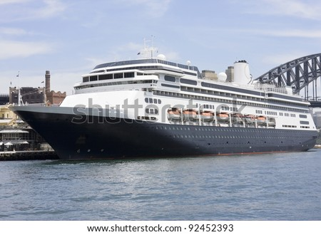 A modern luxury cruise ship anchored at the port - stock photo