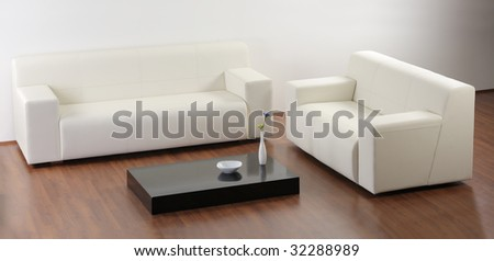 A modern minimalist living-room with white furniture - stock photo