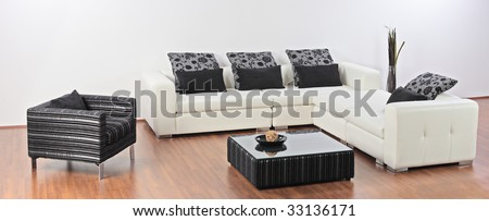 A modern minimalist living-room with white furniture